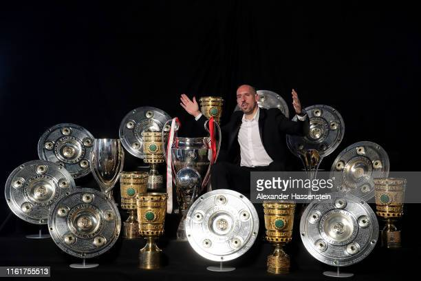 Franck Ribery poses for a picture with all his trophys won with the FC Bayern Muenchen team during an event at FCB Erlebniswelt on May 28, 2019 in...