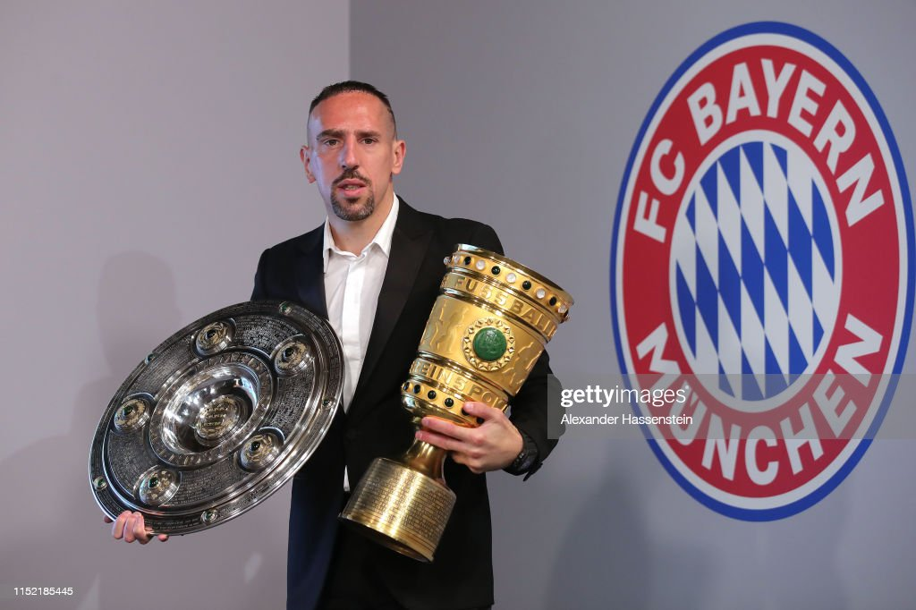 Arjen Robben And Franck Ribery Hand Over Championship And DFB Cup Trophy To FCB Erlebniswelt : News Photo