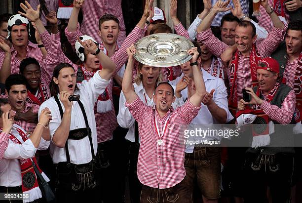 Franck Ribery presents the German championship trophy on the balcony of the city hall during the champions party on the Marienplatz on May 9 2010 in...