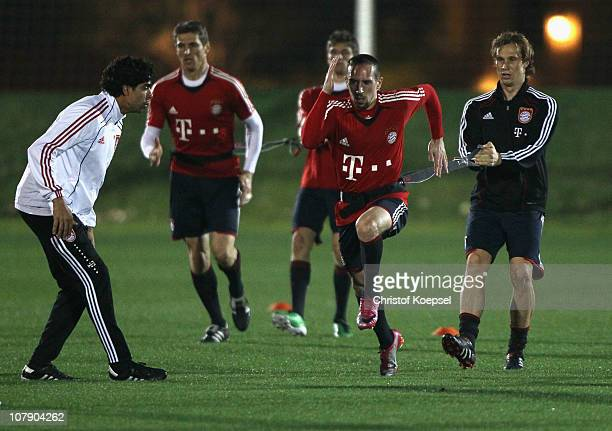 Franck Ribery pulls Holger Badstuber during the FC Bayern Muenchen training session at Aspire Academy for Sports Excellence training ground on...