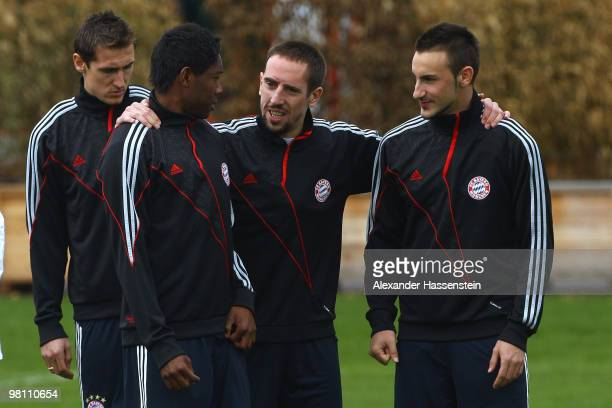 Franck Ribery talks to his team mates David Alaba and Diego Contento during the Bayern Muenchen training session at Bayern's training ground...
