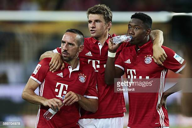Franck Ribery Thomas Mueller and David Alaba of Munich after DFL Supercup 2016 match between Borussia Dortmund and FC Bayern Muenchen at Signal Iduna...