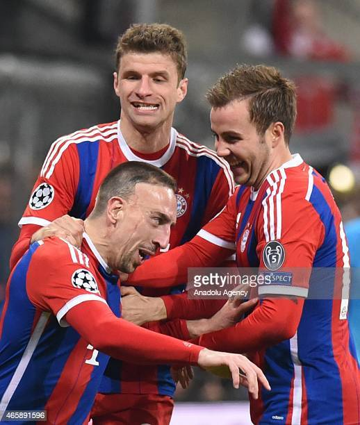 Franck Ribery Thomas Mueller and Mario Goetze of Bayern Munich celebrate a goal during the UEFA Champions League round of 16 second leg match between...