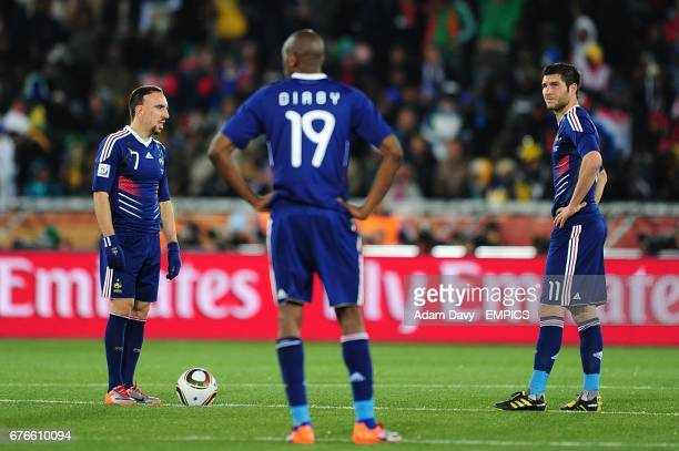 Franck Ribery Vassiriki Diaby and Andre Pierre Gignac appear dejected as the wait to kick off after Mexico's Cuauhtemoc Blanco scored from the...
