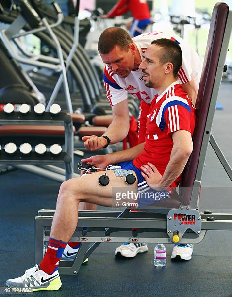 Franck Ribery with physiotherapist Holger Broich exercises in the gym during day 7 of the Bayern Muenchen training camp at ASPIRE Academy for Sports...