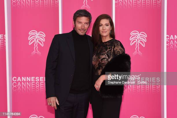 Franck Semonin and his wife Helene pose on the pink carpet prior to the closing ceremony of the 2nd Canneseries International Series Festival on...