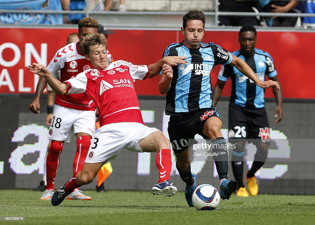 Franck Signorino of Stade de Reims and Florian Thauvin of Olympique de Marseille in action during the French Ligue 1 match between Stade de Reims and Olympique de Marseille (OM) at Stade Auguste Delaune on August 16, 2015 in Reims, France.