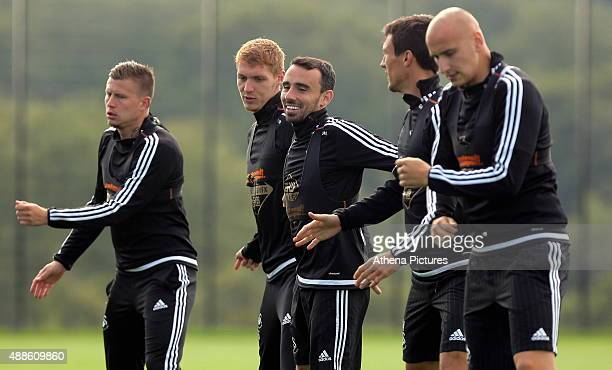 Franck Tabanou Jay Fulton Leon Britton Kyle Naughton and Jonjo Shelvey warm up during the Swansea City Training Session at the Fairwood Training...