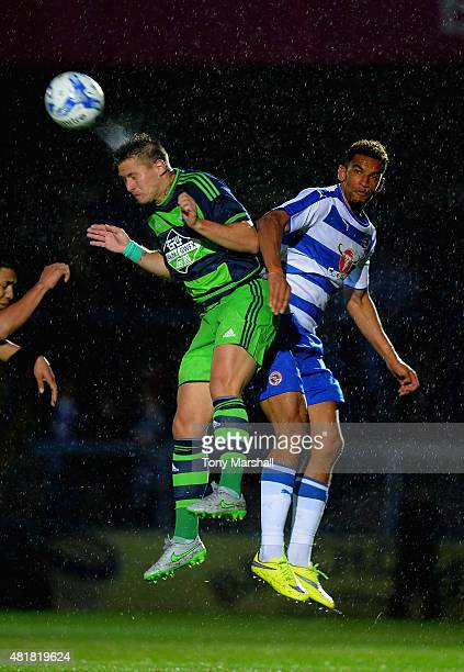 Franck Tabanou of Swansea City wins the ball in the air from Nick Blackman of Reading during the Pre Season Friendly match between Reading and...