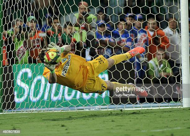 Franco Armani goalkeeper of Atletico Nacional saves a penalty kick in the penalty series during a second leg match between Atletico Nacional and...
