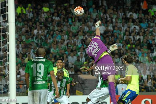 Franco Armani goalkeeper of Nacional makes a save during a group stage match between Atletico Nacional and Sporting Cristal as part of Copa...