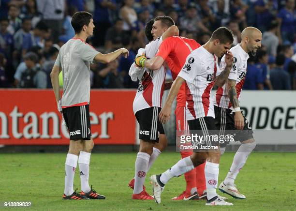 Franco Armani goalkeeper of River Plate celebrates with teammate Ignacio Scocco after winning the match between Emelec and River Plate as part of...