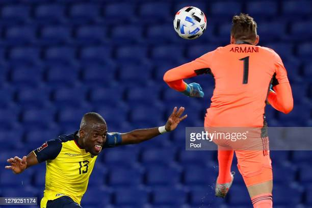 Franco Armani of Argentina makes a save against Enner Valencia of Ecuador during a match between Argentina and Ecuador as part of South American...