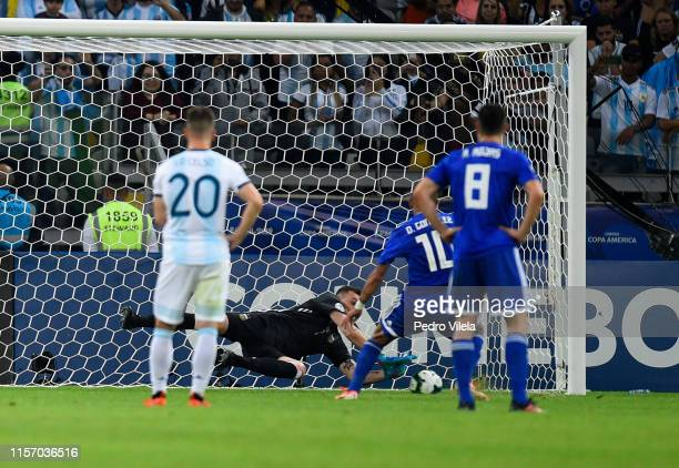 Franco Armani of Argentina saves the penalty kick of Derlis Gonzalez of Paraguay during the Copa America Brazil 2019 group B match between Argentina...