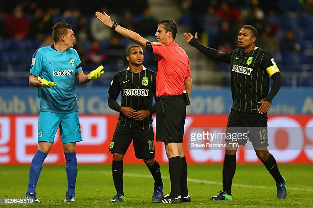 Franco Armani of Atletico Nacional reacts as Match Referee Viktor Kassai awards a penalty for Kashima Antler after he used the video assistant...