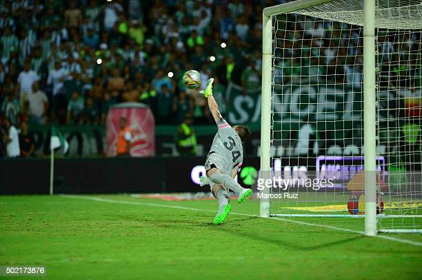 Franco Armani of Atletico Nacional stops a penalty to Gustavo Cuellar during the penalty shootout of the second leg final match between Atletico...
