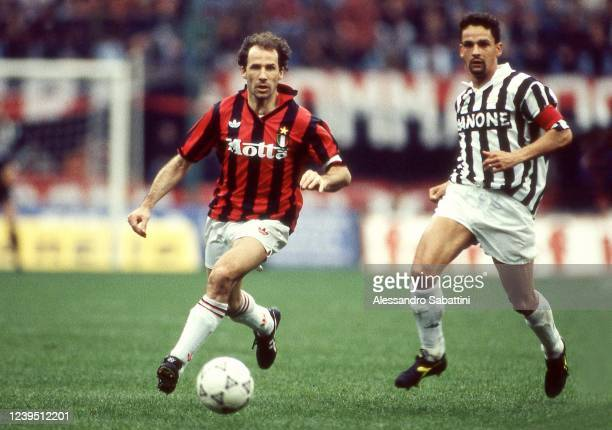 Franco Baresi of AC Milan competes for the ball with Roberto Baggio of Juventus during the Serie A match between AC Milan and Juventus at stadio...