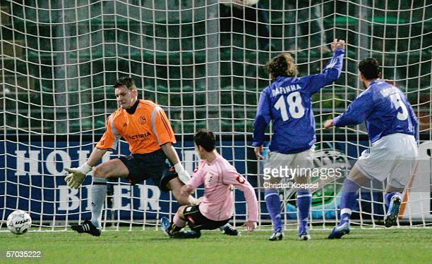 Franco Brienza of Palermo scores the first goal during the UEFA Cup Round of 16 first leg match between Palermo and Schalke 04 at the Stadium Renzo...