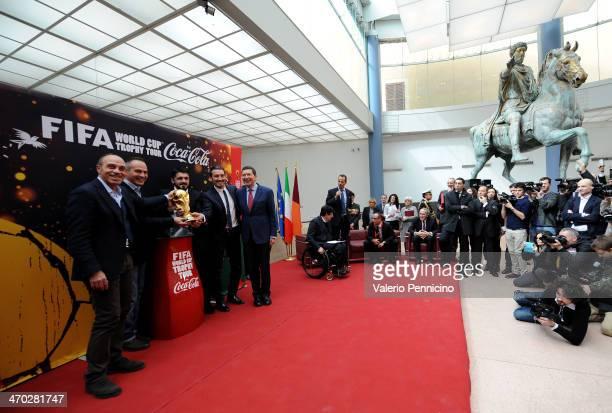 Franco Causio Antonio Cabrini Gennaro Gattuso Gianluca Zambrotta and Mayor of Rome Ignazio Marino pose with the FIFA World Cup trophy at Musei...