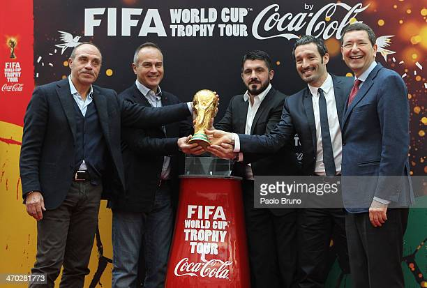 Franco Causio Antonio Cabrini Gennaro Gattuso Gianluca Zambrotta and Mayor of Rome Ignazio Marino pose with the FIFA World Cup trophy during day one...