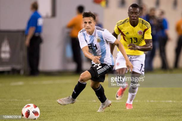 Franco Cervi of Argentina challenged by Helibelton Palacios of Colombia during the Argentina Vs Colombia International Friendly football match at...