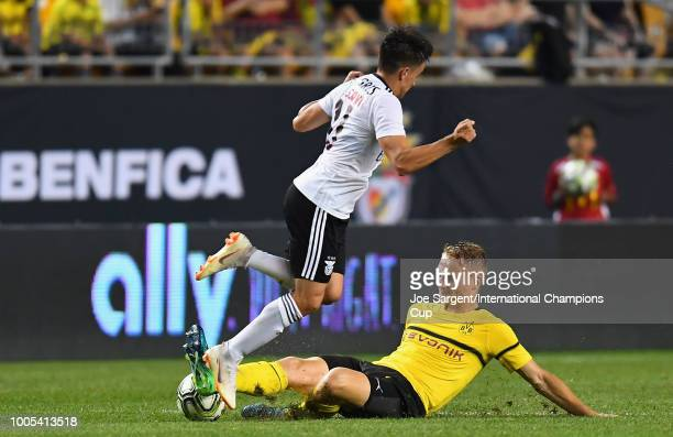 Franco Cervi of Benficaleaps over Amos Pieper of Borussia Dortmund during the second half of the International Champions Cup 2018 match at Heinz...