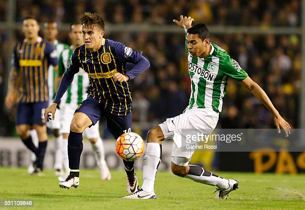 Franco Cervi of Rosario Central fights for the ball with Daniel Bocanegra of Atletico Nacional during a first leg match between Rosario Central and...