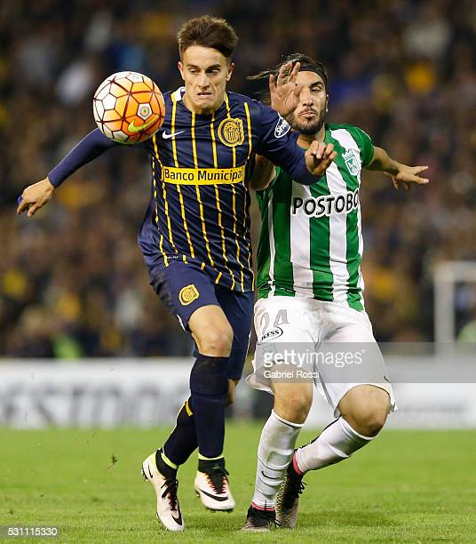 Franco Cervi of Rosario Central fights for the ball with Sebastian Perez of Atletico Nacional during a first leg match between Rosario Central and...