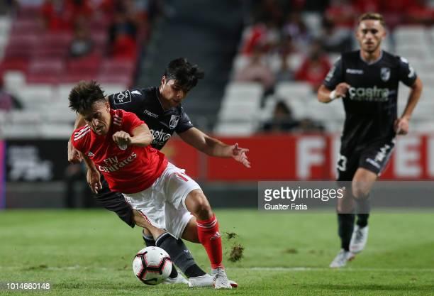 Franco Cervi of SL Benfica tackled by Joao Carlos Teixeira of Vitoria SC during the Liga NOS match between SL Benfica and Vitoria SC at Estadio da...