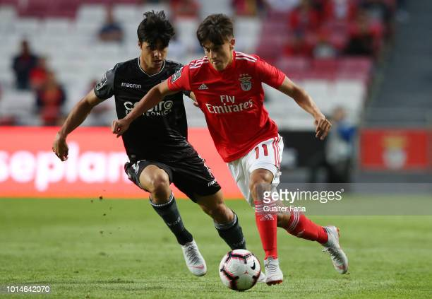 Franco Cervi of SL Benfica with Joao Carlos Teixeira of Vitoria SC in action during the Liga NOS match between SL Benfica and Vitoria SC at Estadio...