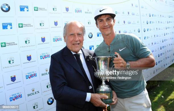 Franco Chimenti President of the Italian Golf Federation poses for a photo with the Winner of the Italian Open Thorbjorn Olesen of Denmark during the...