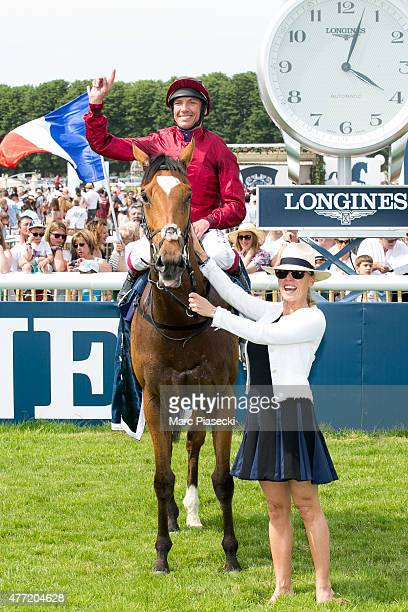 Franco Dettori winner of the 'Prix de Diane Longines 2015' and wife Catherine Dettori celebrate their victory at Hippodrome de Chantilly on June 14...