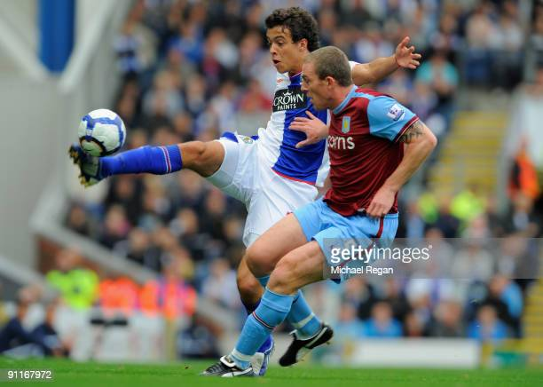 Franco Di Santo of Blackburn is challenged by Richard Dunn of Aston Villa during the Barclays Premier League match between Blackburn Rovers and Aston...