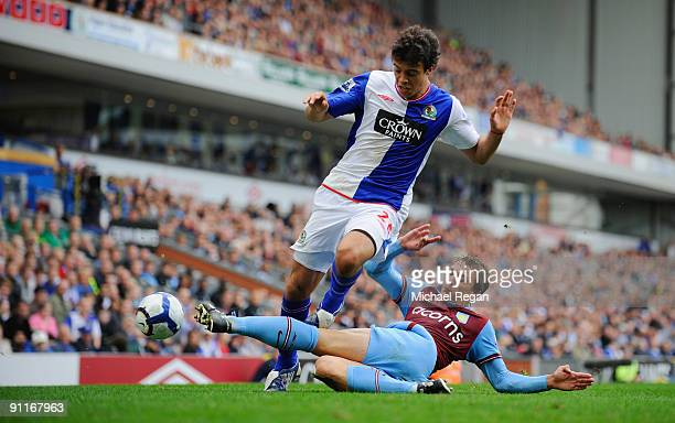 Franco Di Santo of Blackburn is tackled by Stephen Warnock of Aston Villa during the Barclays Premier League match between Blackburn Rovers and Aston...