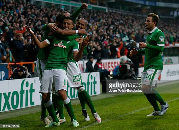 Franco di Santo of Bremen celebrates with his team mates after scoring his team's first goal during the Bundesliga match between Werder Bremen and...