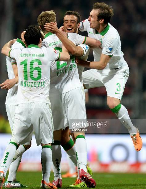 Franco di Santo of Bremen celebrates with teammates after scoring the opening goal during the Bundesliga match between 1 FC Nuernberg and Werder...