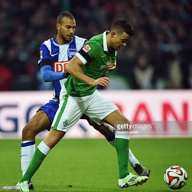 Franco di Santo of Bremen is challenged by John Anthony Brooks of Berlin during the Bundesliga match between SV Werder Bremen and Hertha BSC at...