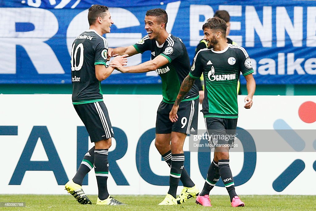 Franco Di Santo #9 of FC Schalke 04 celebrates scoring a goal with team mates during the DFB Cup match between MSV Duisburg and FC Schalke 04 held at Schauinsland-Reisen-Arena on August 8, 2015 in Duisburg, Germany.