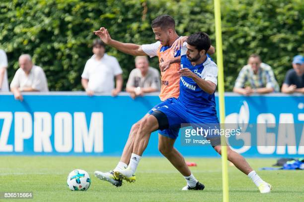 Franco Di Santo of Schalke and Pablo Insua of Schalke battle for the ball during a training session at the FC Schalke 04 Training center on July 3...