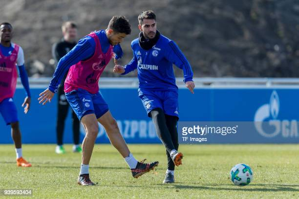 Franco Di Santo of Schalke and Pablo Insua of Schalke battle for the ball during a training session at the FC Schalke 04 Training center on March 26...