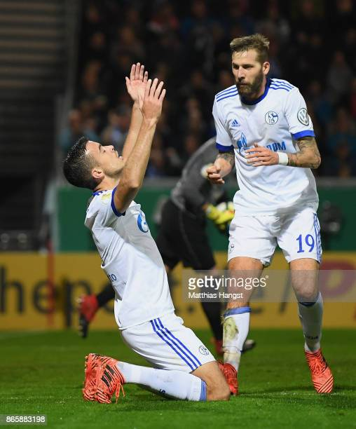 Franco Di Santo of Schalke celebrates with his teammates after scoring his team's first goal during the DFB Cup match between SV Wehen Wiesbaden and...