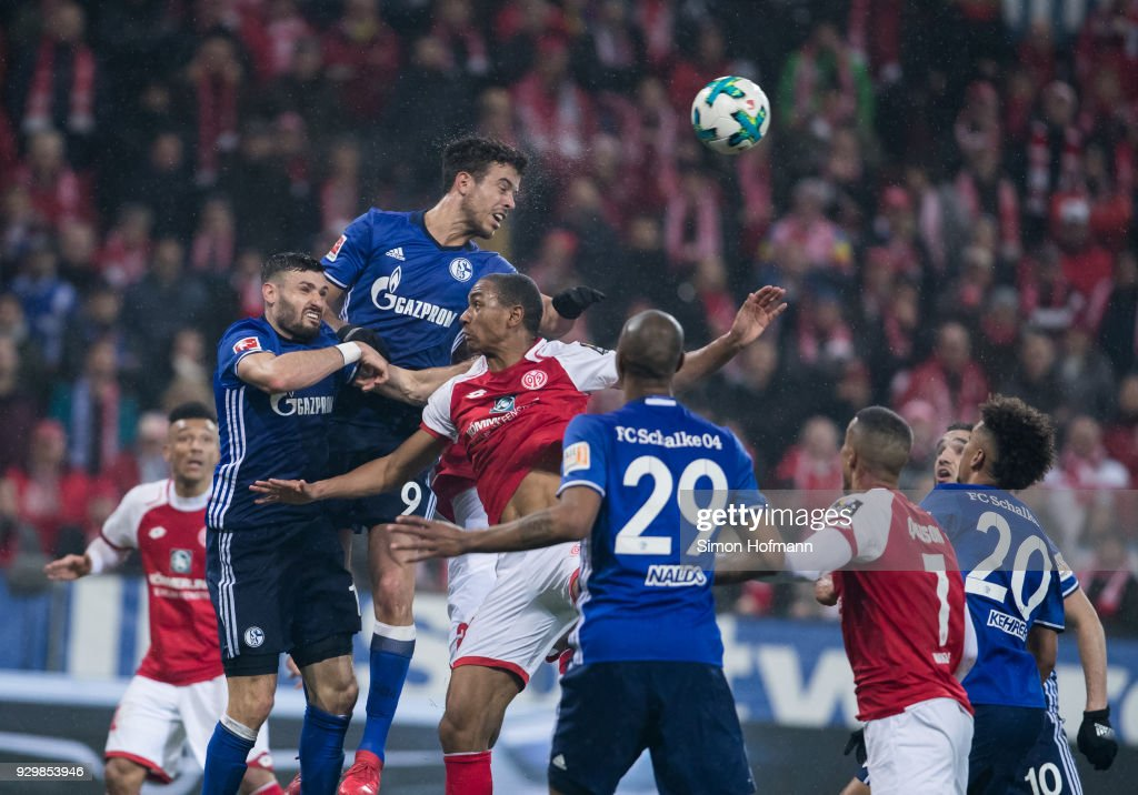 Franco Di Santo of Schalke jumps for a header with Abdou Diallo of Mainz during the Bundesliga match between 1. FSV Mainz 05 and FC Schalke 04 at Opel Arena on March 9, 2018 in Mainz, Germany.