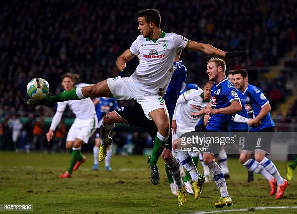 Franco Di Santo of Werder Bremen jumps for the ball during the round of 16 DFB Cup match between Arminia Bielefeld and Werder Bremen on March 4 2015...