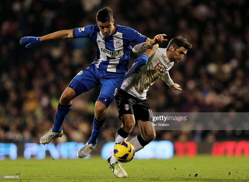 Franco Di Santo of Wigan and Aaron Hughes of Fulham compete for the ball during the Barclays Premier League match between Fulham and Wigan Athletic at Craven Cottage on January 12, 2013 in London, England.