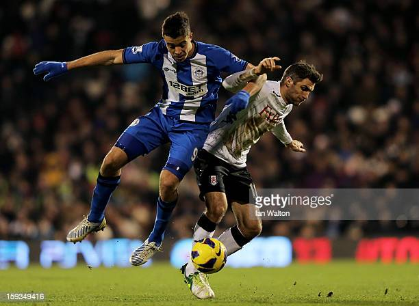 Franco Di Santo of Wigan and Aaron Hughes of Fulham compete for the ball during the Barclays Premier League match between Fulham and Wigan Athletic...