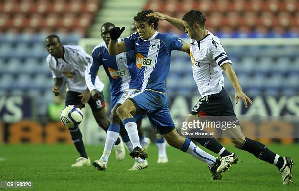 Franco Di Santo of Wigan Athletic holds off a challenge from Gary Cahill of Bolton Wanderers during the FA Cup sponsored by EON 4th round replay...
