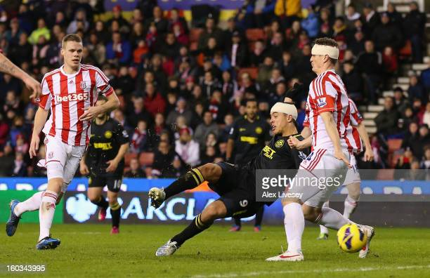Franco Di Santo of Wigan Athletic scores their second goal during the Barclays Premier League match between Stoke City and Wigan Athletic at the...