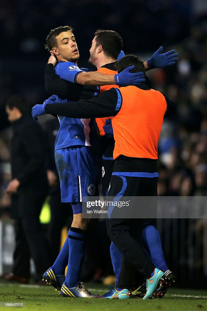 Franco Di Santo (L) of Wigan is congratulated by teammates after scoring the goal to level the scores at 1-1 during the Barclays Premier League match between Fulham and Wigan Athletic at Craven Cottage on January 12, 2013 in London, England.