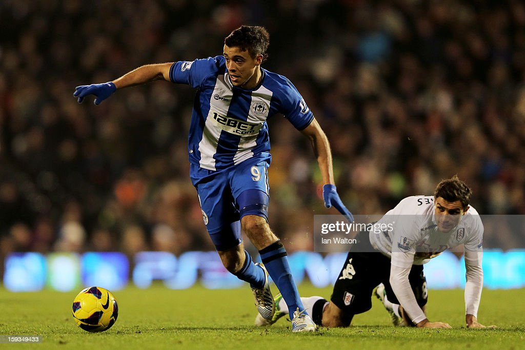 Franco Di Santo of Wigan pulls away from Aaron Hughes of Fulham during the Barclays Premier League match between Fulham and Wigan Athletic at Craven Cottage on January 12, 2013 in London, England.