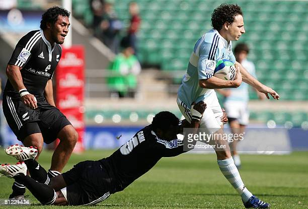 Franco Fasano of Argentina is stopped by Tomasi Cama of New Zealand during the Pool A match between New Zealand and Argentina during the IRB Emirates...